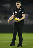 Magpies midfield coach Scott Burns looks on during the warm up session prior to the round two AFL match between the Collingwood Magpies and the...