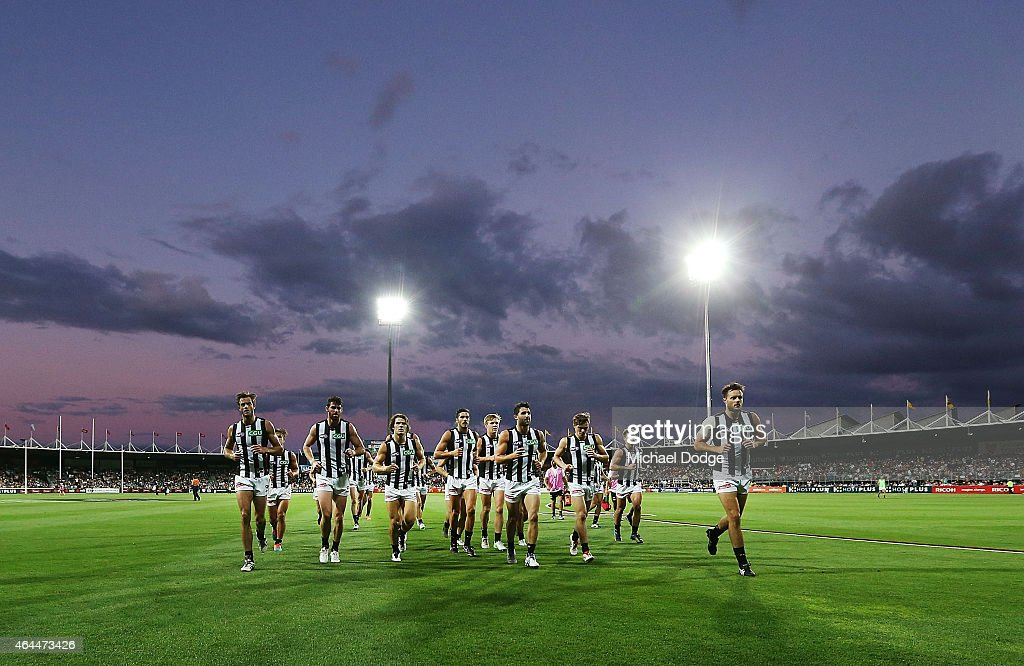 Magpies players run off at half time during the NAB Challenge AFL match between Hawthorn Hawks and the Collingwood Magpies at Aurora Stadium on...