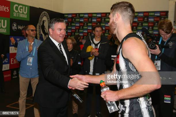 Magpies President Eddie Maguire congratulates Matthew Scharenberg of the Magpies on winning during the round 10 AFL match between the Collingwood...