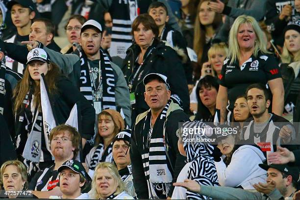 Magpies supporters in the crowd look on as a Cats player lines up a shot at goal during the round six AFL match between the Collingwood Magpies and...