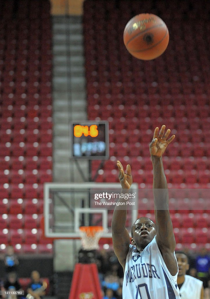 Magruder's JJ Epps (10) sinks one of two clinching free throws in the closing seconds as Magruder defeats Eleanor Roosevelt 39-36 to win the Maryland 4A basketball championship at the Comcast Center in College Park, Maryland, Saturday, March 10, 2012.