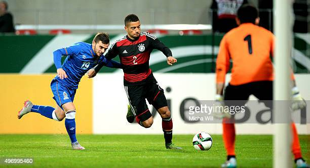 Magsad Isayev of Azerbaijan challenges Jeremy Toljan of Germany during the 2017 UEFA European U21 Championships Qualifier between U21 Germany and U21...