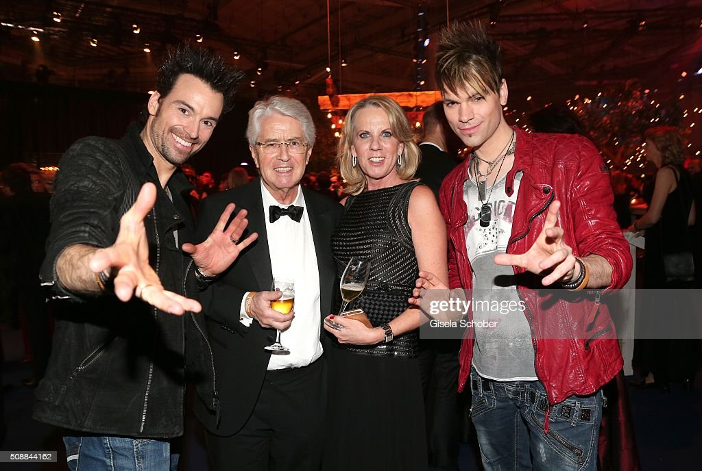 Magus Christian Ehrlich (R) and his brother Andreas Ehrlich (L) , the Ehrlich Brothers , Frank Elstner and his wife Britta (C) during the after show party of the Goldene Kamera 2016 on February 6, 2016 in Hamburg, Germany.