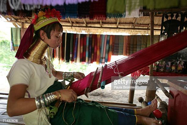Mah Chan a Long Neck Padaung hill tribe woman weaves a scraf for sale to tourists in a small village where 30 familes live July 13 2006 in Chiang Dao...