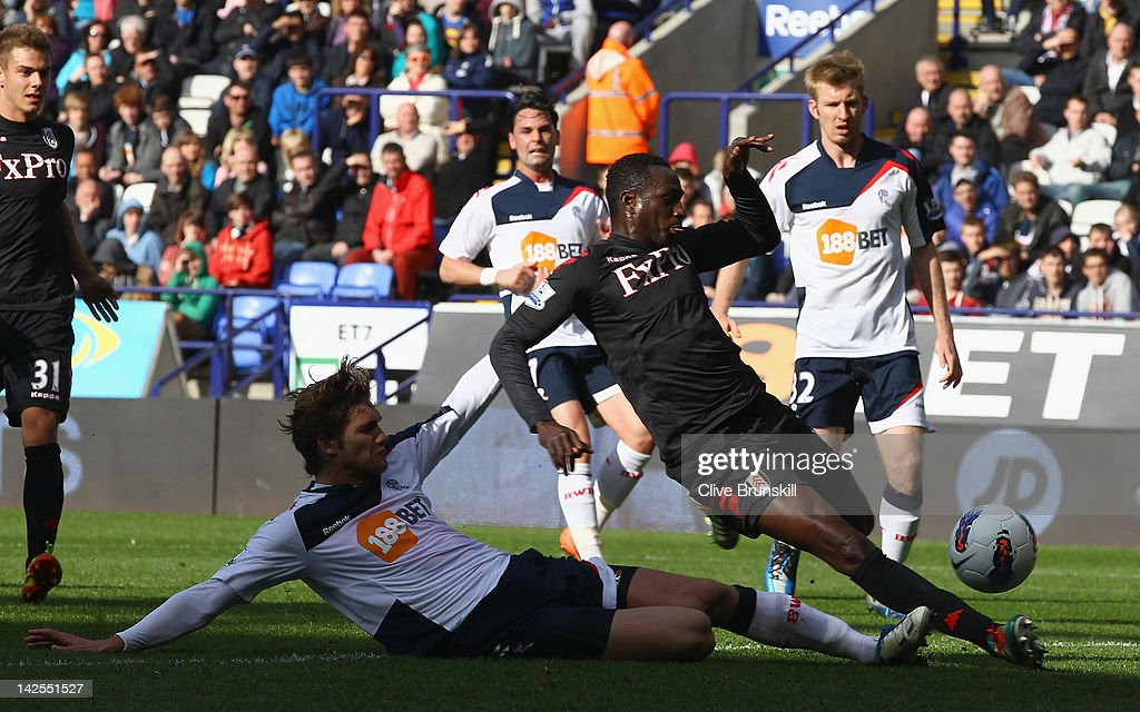 Mahamadou Diarra of Fulham beats a challenge from Marcos Alonso of Bolton Wanderers to score the third goal during the Barclays Premier League match between Bolton Wanderers and Fulham at Reebok Stadium on April 7, 2012 in Bolton, England.