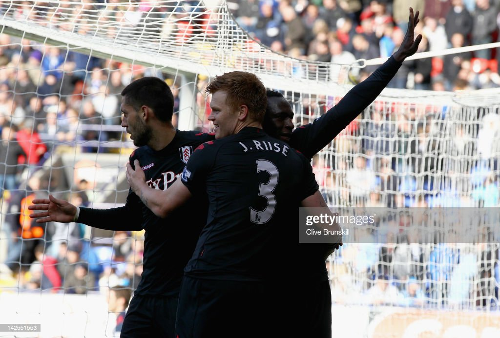 Mahamadou Diarra of Fulham celebrates with John Arne Riise after scoring the third goal during the Barclays Premier League match between Bolton Wanderers and Fulham at Reebok Stadium on April 7, 2012 in Bolton, England.