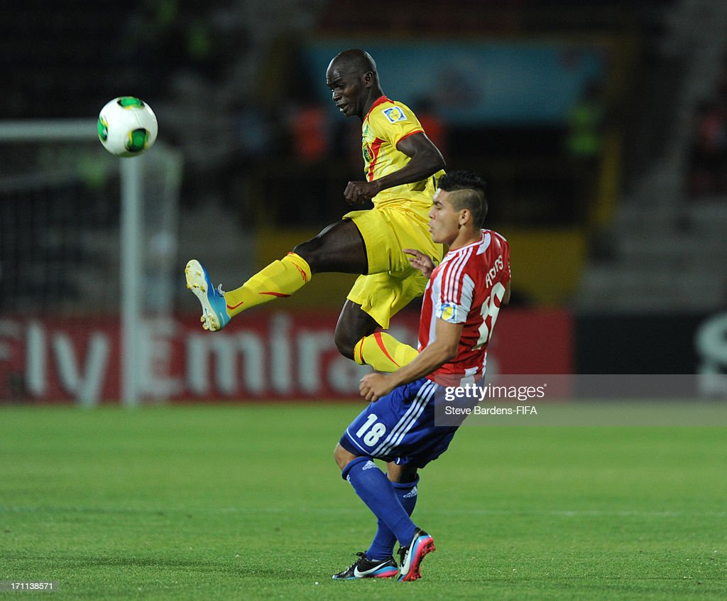 Mahamadoue Traore of Mali wins the ball from Jorge Rojas of Paraguay during the FIFA U20 World Cup Group D match between Paraguay and Mali at Kamil Ocak Stadium on June 22, 2013 in Gaziantep, Turkey.