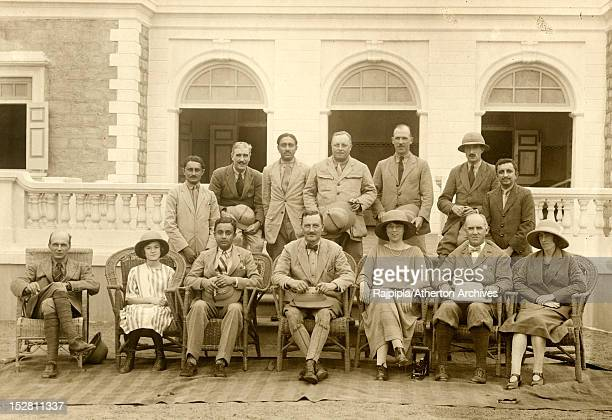 Maharajah Vijayasinhji of Rajpipla poses with guests outside the annexe of Vijay Palace during the state visit of British Governor of Bombay Sir...