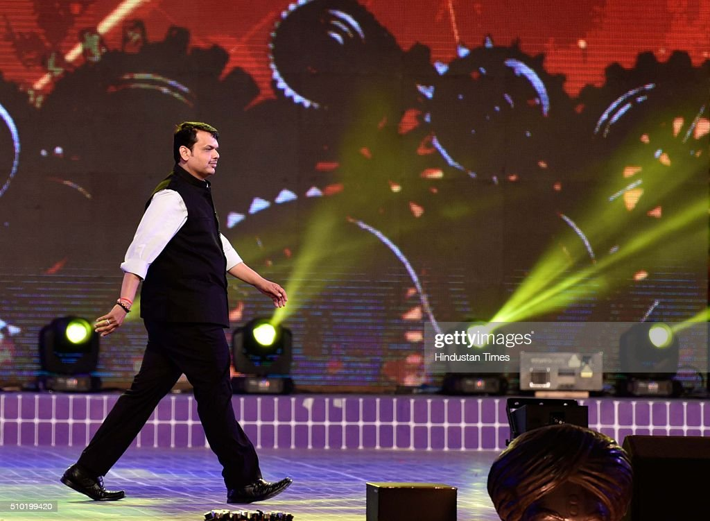 Maharashtra Chief Minister Devendra Fadnavis during a 'Make in India week' cultural programme at Maharashtra Night at Girgaum Chowpatty on February 14, 2016 in Mumbai, India. The fire broke out almost 10 minutes after Maharashtra CM Devendra Fadnavis delivered his speech at the event, during a lavani performance. The stage collapsed under the impact of the fire. However, no casualties were reported and the venue, at the Girgaum Chowpatty area, was evacuated very soon. Around 16 fire tenders put out the fire in 10 minutes. No casualties have been reported yet. Prime Minister Modi had inaugurated the Make in India Week yesterday as a showcase event for the government's flagship manufacturing scheme.