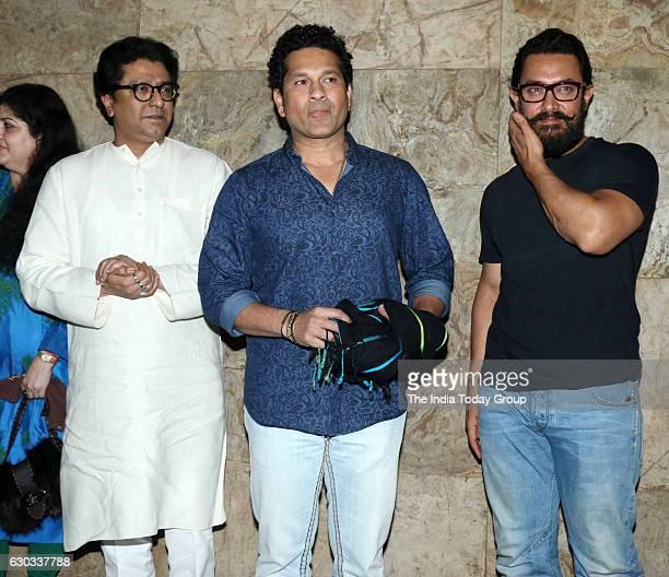 Maharashtra Navnirman Sena president Raj Thackeray former cricket player Sachin Tendulkar and actor Aamir Khan during the special screening of film...