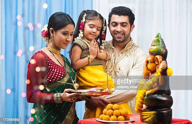 Maharashtrian family celebrating Ganesh Chaturthi festival