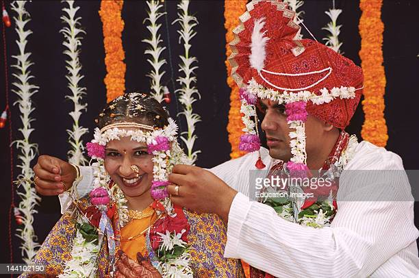Maharashtrian Indian Bride And Indian Bride Groom Perfoming Mangalshutra Vidhi In Wedding Ceremony