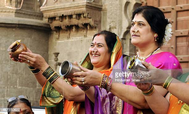 Maharashtrian women offering water to rising Son on the occasion of Gudi Padwa at Rajwada on March 21 2015 in Indore India Celebrated on the first...