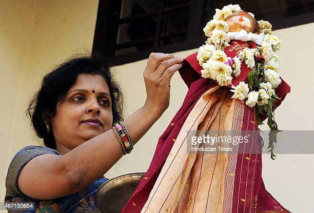 A maharishtrian woman performing pooja on the occasion of Gudi Padwa at Rajwada on March 21 2015 in Indore India Celebrated on the first day of the...