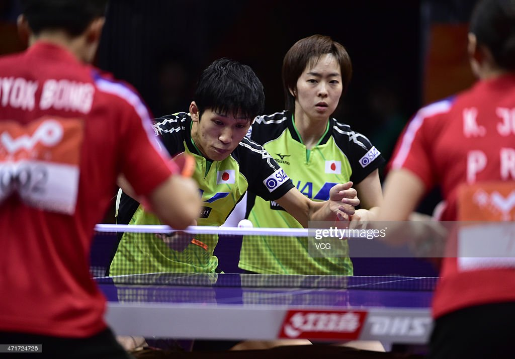Maharu Yoshimura and Kasumi Ishikawa of Japan compete against Kim Hyok Bong and Kim Jong of North Korea during Mixed Doubles Semi-final Match on day five of the 2015 World Table Tennis Championships on April 30, 2015 in Suzhou, China.