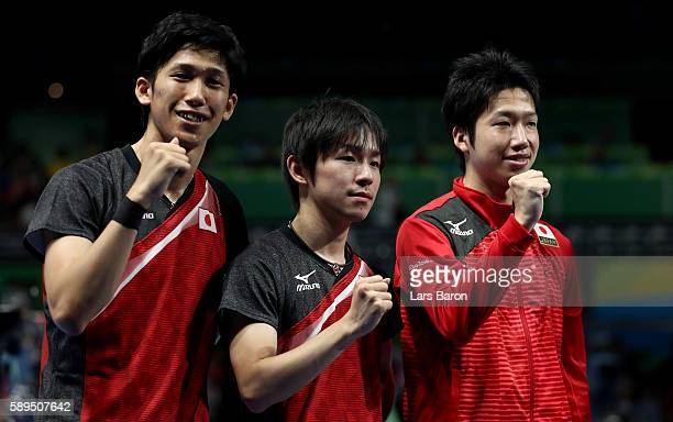 Maharu Yoshimura Koki Niwa and Jun Mizutani pose for a picture after winning the Table Tennis Men's Quarterfinal Match between Japan and Hong Kong on...