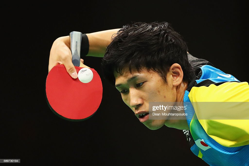 Maharu Yoshimura of Japan returns against Dimitrij Ovtcharov of Germany during Mens Team Semifinal on Day 10 of the Rio 2016 Olympic Games at Riocentro - Pavilion 3 on August 15, 2016 in Rio de Janeiro, Brazil.