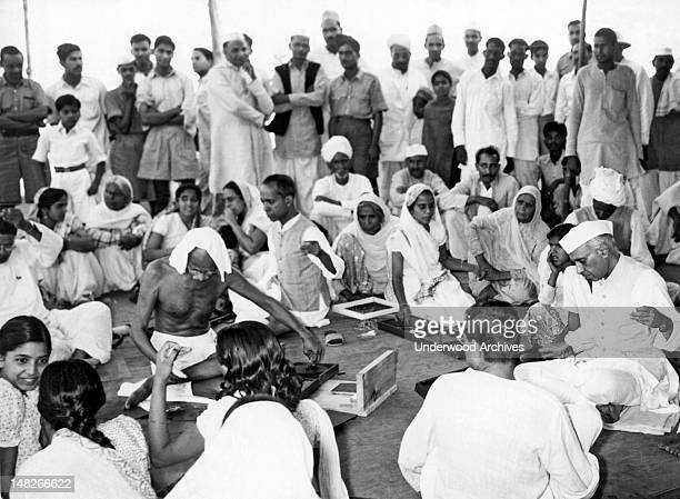 Mahatma Gandhi and Pandit Jawaharlal Nehru participate in a 'charkha' demonstration held in the Bhangi colony in New Delhi in connection with the...