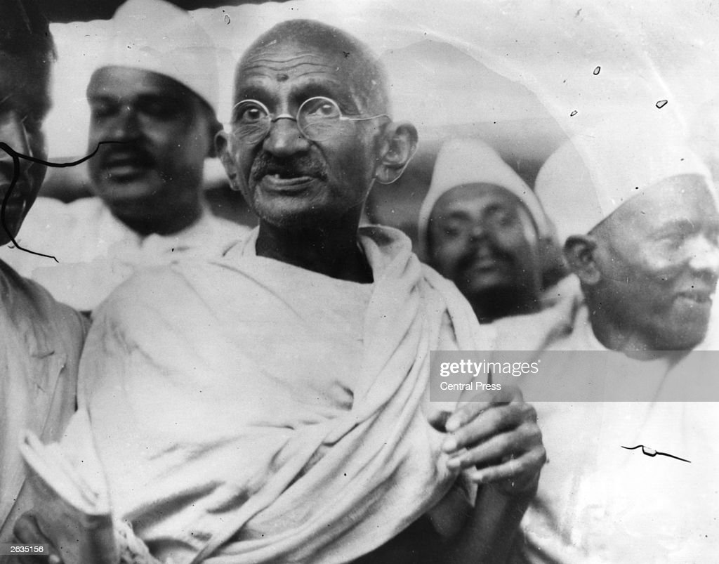 Mahatma Gandhi (Mohandas Karamchand Gandhi,1869 - 1948), Indian nationalist and spiritual leader, leading the Salt March in protest against the government monopoly on salt production.