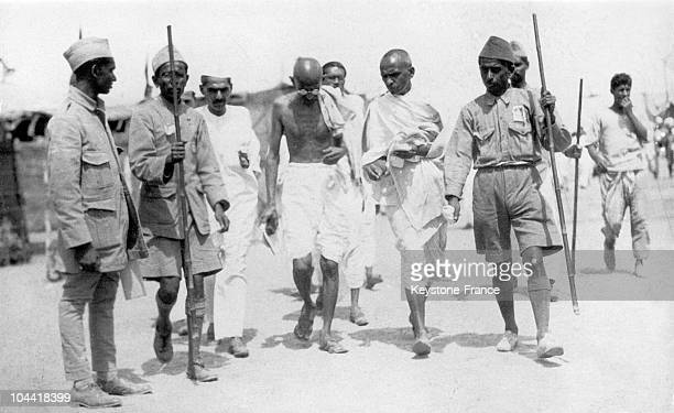Mahatma GANDHI photographed upon his release from the prison in Poona walking with some of his followers between 19141922
