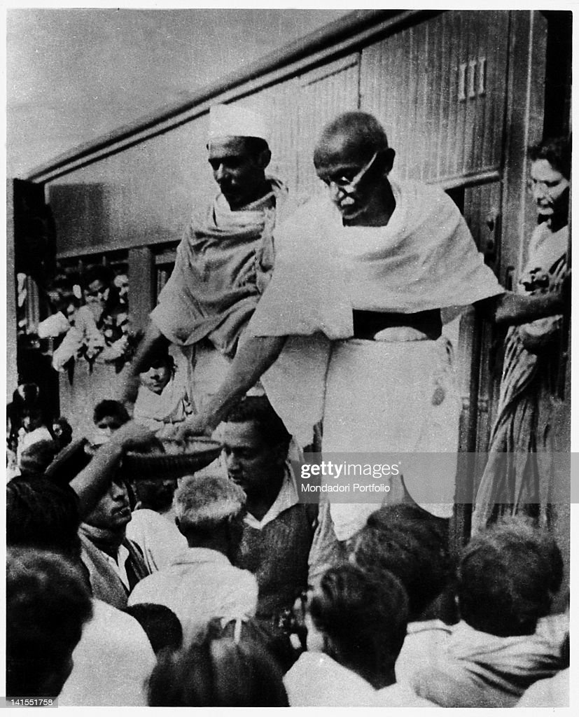Mahatma Gandhi raising money for the Harijans on the footboard of a stationary train wagon at a station The Harijans were considered Parias or Dalits...