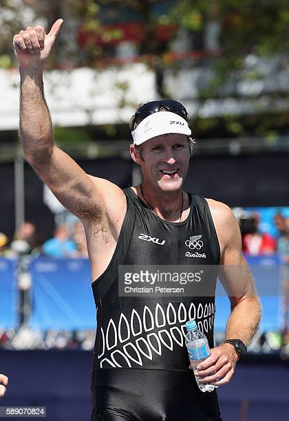 Mahe Drysdale of New Zealand celebrates after winning the gold medal in the Men's Single Sculls on Day 8 of the Rio 2016 Olympic Games at the Lagoa...