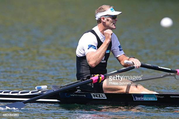 Mahe Drysdale of New Zealand celebrates victory in the Men's Single Sculls Final A during Day 3 of the 2015 World Rowing Cup III on Lucerne Rotsee on...