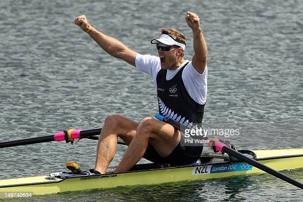 Mahe Drysdale of New Zealand celebrates winning gold in the Men's Single Sculls final on Day 7 of the London 2012 Olympic Games at Eton Dorney on...
