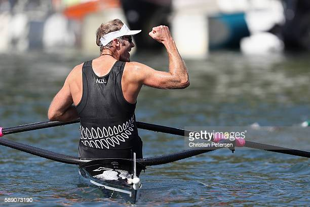 Mahe Drysdale of New Zealand waves after winning the gold medal in the Men's Single Sculls on Day 8 of the Rio 2016 Olympic Games at the Lagoa...