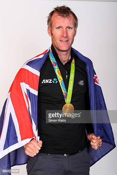 Mahe Drysdale poses for a portrait with his Olympic Gold medal during the New Zealand Olympic Games athlete home coming at Auckland International...