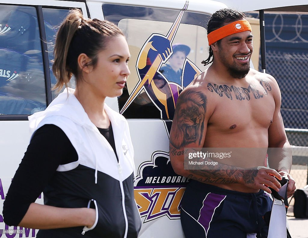 Mahe Fonua gets changed into his training gear during a Melbourne Storm NRL training session at Gosch's Paddock on August 22, 2014 in Melbourne, Australia.