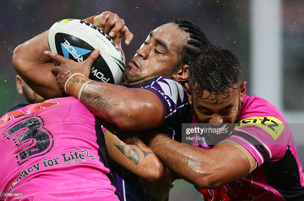 Mahe Fonua of Storm is tackled during the round two NRL match between the Melbourne Storm and the Penrith Panthers at AAMI Park on March 15, 2014 in Melbourne, Australia.