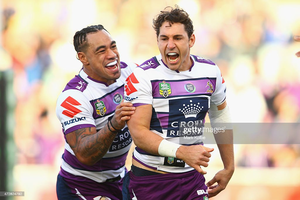 Mahe Fonua of the Storm congratulates Billy Slater of the Storm after he scored a try during the round nine NRL match between the Parramatta Eels and...