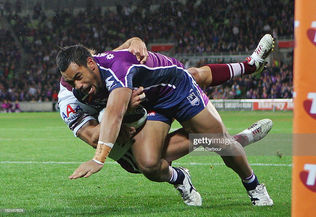Mahe Fonua of the Storm is tackled during the NRL Preliminary Final match between the Melbourne Storm and the Manly Sea Eagles at AAMI Park on September 21, 2012 in Melbourne, Australia.