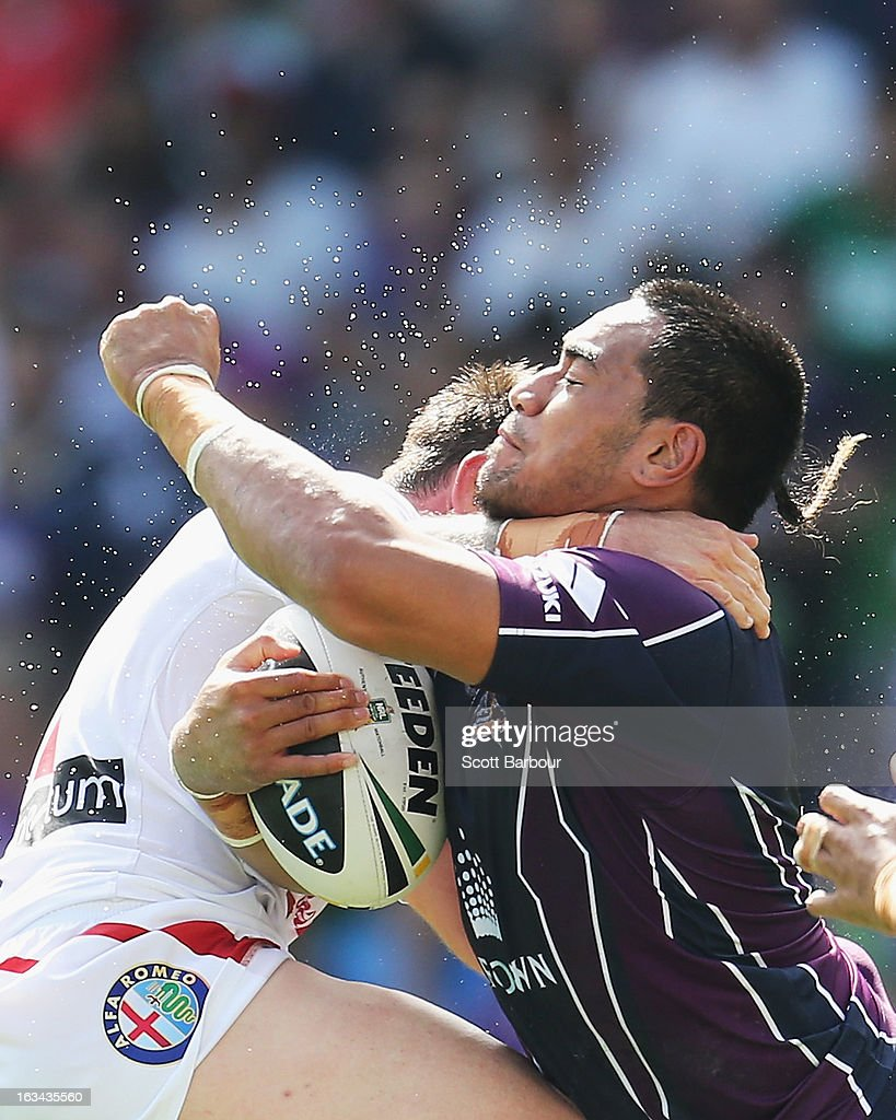 Mahe Fonua of the Storm is tackled during the round one NRL match between the Melbourne Storm and the St George Illawarra Dragons at AAMI Park on March 10, 2013 in Melbourne, Australia.