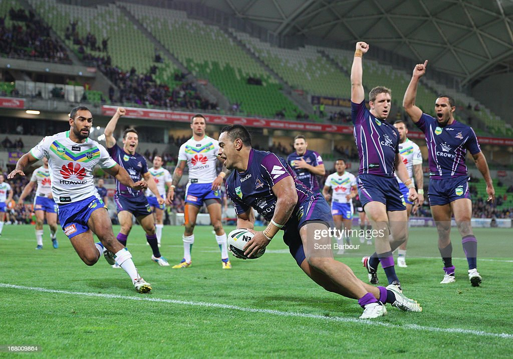 Mahe Fonua of the Storm scores a try during the round eight NRL match between the Melbourne Storm and the Canberra Raiders at AAMI Park on May 4, 2013 in Melbourne, Australia.