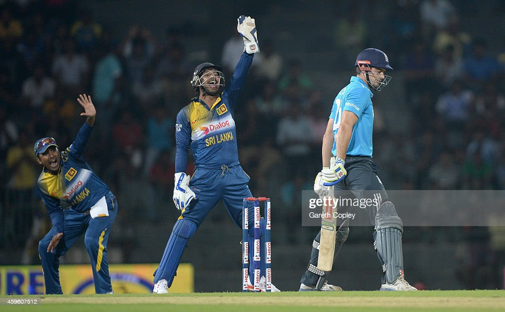 Mahela Jayawardena and Kumar Sangakkara of Sri Lanka successfully appeal for the wicket of England captain Alastair Cook during the 1st One Day...