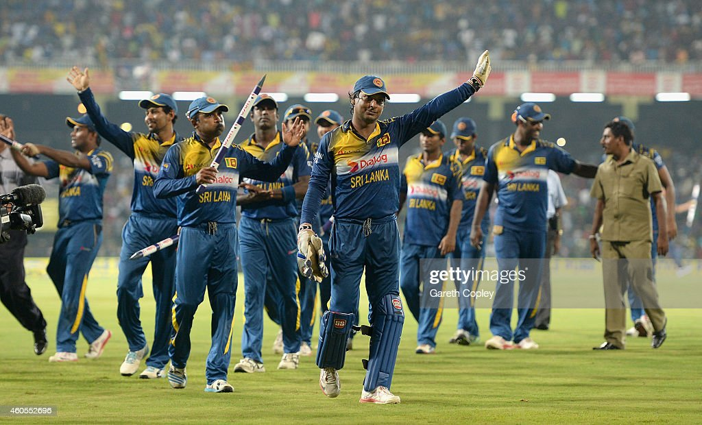 Mahela Jayawardena and Kumar Sangakkara of Sri Lanka wave the crowd after winning the 7th One Day International match between Sri Lanka and England at R. Premadasa Stadium on December 16, 2014 in Colombo, Sri Lanka.