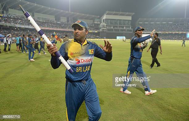 Mahela Jayawardena and Kumar Sangakkara of Sri Lanka wave the crowd after winning the 7th One Day International match between Sri Lanka and England...