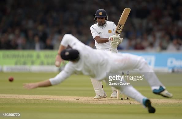 Mahela Jayawardena of Sri Lanka hits past Ian Bell of England during day three of 1st Investec Test match between England and Sri Lanka at Lord's...