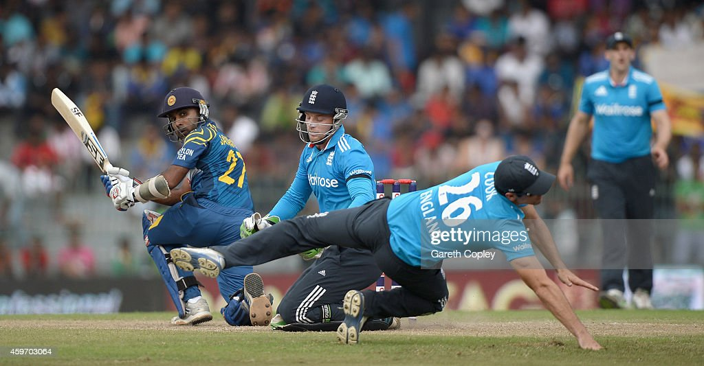 Mahela Jayawardena of Sri Lanka hits past Jos Buttler and England captain Alastair Cook during the 2nd One Day International match between Sri Lanka...