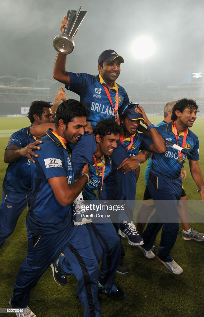Mahela Jayawardena of Sri Lanka is chaired from the field by Sachithra Senanayake and Dinesh Chandimal after winning the ICC World Twenty20...