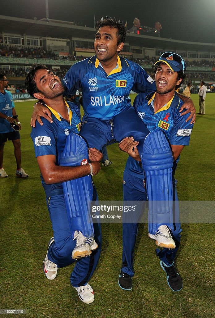 Mahela Jayawardena of Sri Lanka is chaired from the field by <a gi-track='captionPersonalityLinkClicked' href=/galleries/search?phrase=Lahiru+Thirimanne&family=editorial&specificpeople=5946377 ng-click='$event.stopPropagation()'>Lahiru Thirimanne</a> and <a gi-track='captionPersonalityLinkClicked' href=/galleries/search?phrase=Dinesh+Chandimal&family=editorial&specificpeople=4884949 ng-click='$event.stopPropagation()'>Dinesh Chandimal</a> after winning the ICC World Twenty20 Bangladesh 2014 Final between India and Sri Lanka at Sher-e-Bangla Mirpur Stadium on April 6, 2014 in Dhaka, Bangladesh.