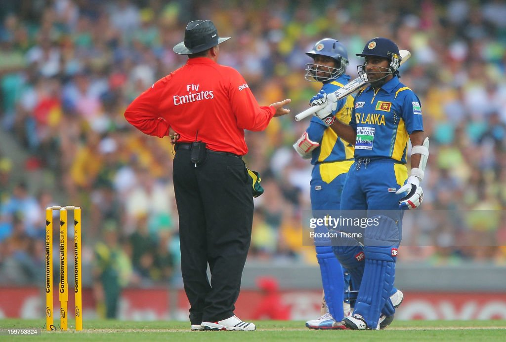 Mahela Jayawardena of Sri Lanka speaks with umpire Marais Erasmus before play is suspended due to rain during game four of the Commonwealth Bank one day international series between Australia and Sri Lanka at Sydney Cricket Ground on January 20, 2013 in Sydney, Australia.