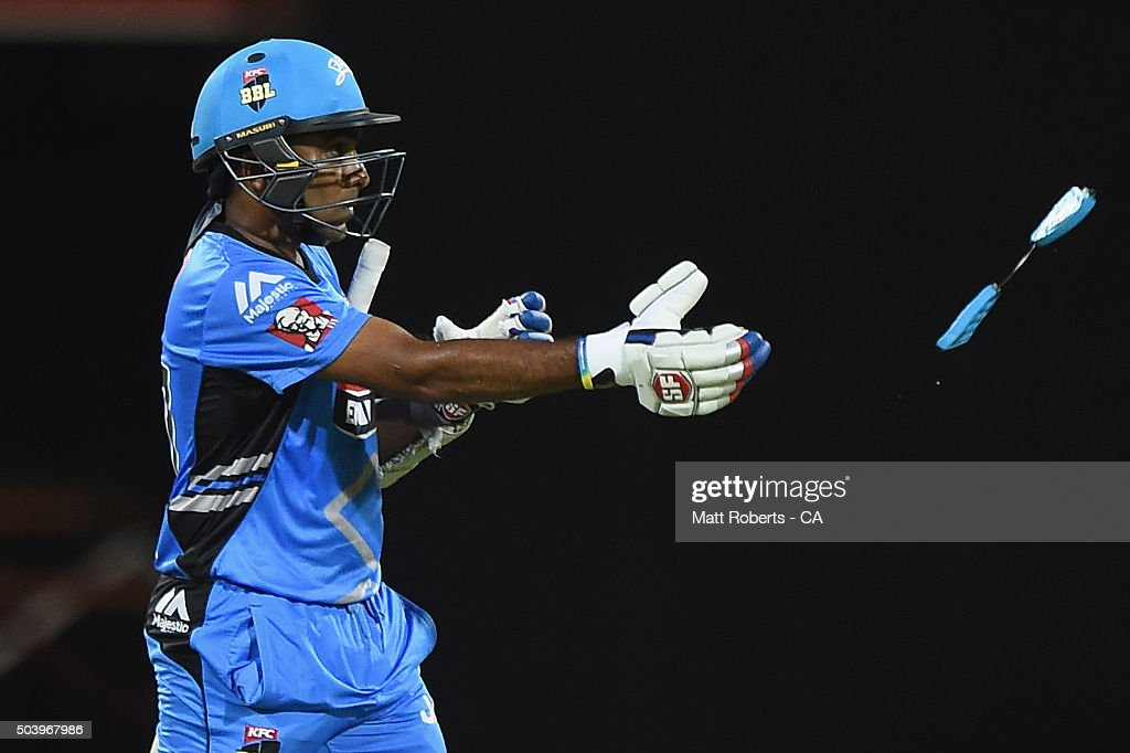 Mahela Jayawardena of the Strikers throws part of his helmet to an umpire after being stuck by the ball while batting during the Big Bash League...