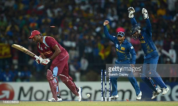 Mahela Jayawardene and Kumar Sangakkara of Sri Lanka celebrate after Kieron Pollard of the West Indies is bowled by Ajantha Mendis during the ICC...