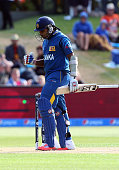 Mahela Jayawardene of Sri Lanka celebrates his 100 runs during the 2015 ICC Cricket World Cup match between Sri Lanka and Afghanistan at University...