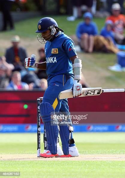 Mahela Jayawardene of Sri Lanka celebrates his 100 runs during the 2015 ICC Cricket World Cup match between Sri Lanka and Afghanistan at University...