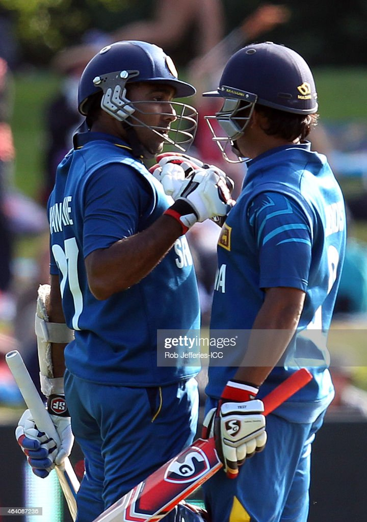 <a gi-track='captionPersonalityLinkClicked' href=/galleries/search?phrase=Mahela+Jayawardene&family=editorial&specificpeople=213707 ng-click='$event.stopPropagation()'>Mahela Jayawardene</a> of Sri Lanka celebrates his 100 runs with <a gi-track='captionPersonalityLinkClicked' href=/galleries/search?phrase=Jeevan+Mendis&family=editorial&specificpeople=7037737 ng-click='$event.stopPropagation()'>Jeevan Mendis</a> during the 2015 ICC Cricket World Cup match between Sri Lanka and Afghanistan at University Oval on February 22, 2015 in Dunedin, New Zealand.