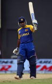 Mahela Jayawardene of Sri Lanka celebrates his century during the ICC T20 World Cup Group B match between Sri Lanka and Zimbabwe at the Guyana...